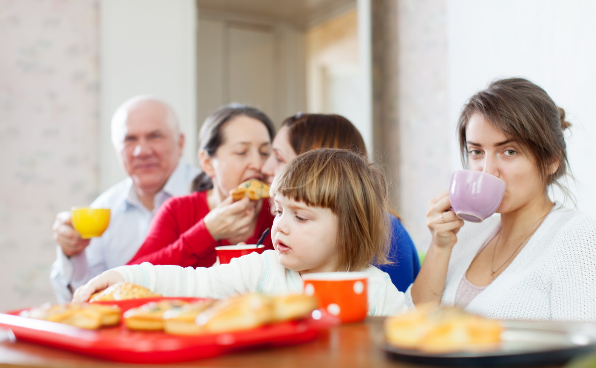 happy multigeneration family communicate around tea table